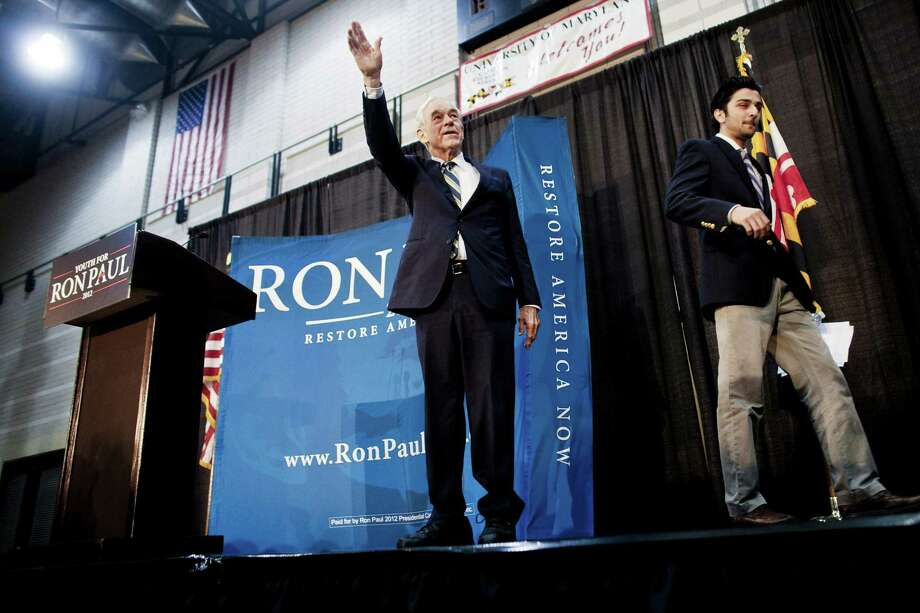 Ron Paul takes the stage after an introduction from Mo Mohsen Frash, president of the University of Maryland Youth for Ron Paul chapter, during a town hall meeting at the University of Maryland on March 28, 2012 in College Park, Maryland. Photo: T.J. Kirkpatrick, Getty Images / 2012 Getty Images