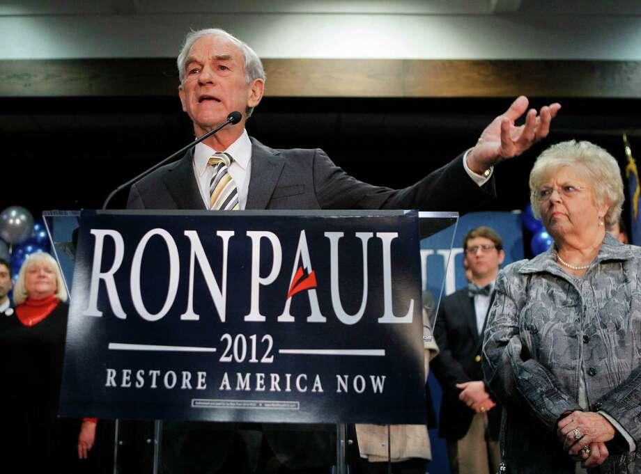 Ron Paul, with his wife Carol Paul, speaks to supporters in Portland, Maine, after his loss in the Maine caucus to Mitt Romney. Photo: Robert F. Bukaty, Associated Press / AP