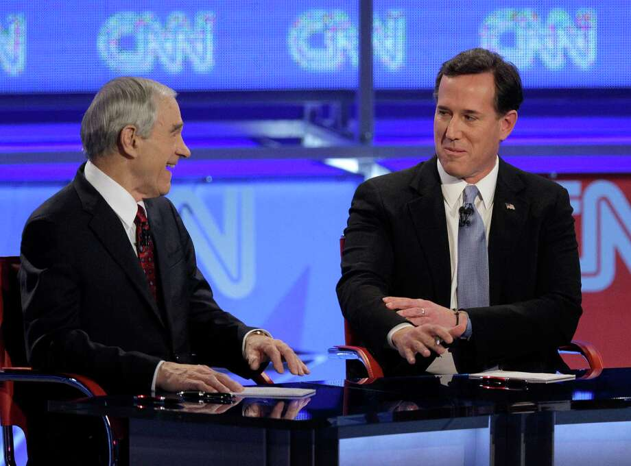 Rick Santorum reacts to a comment by Ron Paul during a Republican presidential debate Wednesday, Feb. 22, 2012, in Mesa, Ariz. Photo: Jae C. Hong, Associated Press / AP