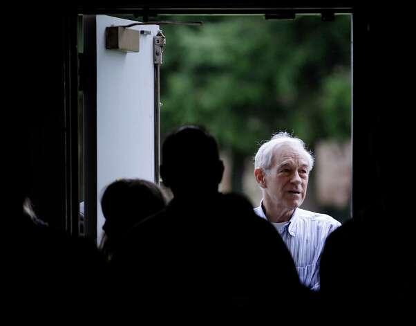 Ron Paul looks back into the room where he spoke to voters participating in Washington state caucus meetings, Saturday, March, 3, 2012, in Puyallup, Wash. Photo: Ted S. Warren, Associated Press / AP