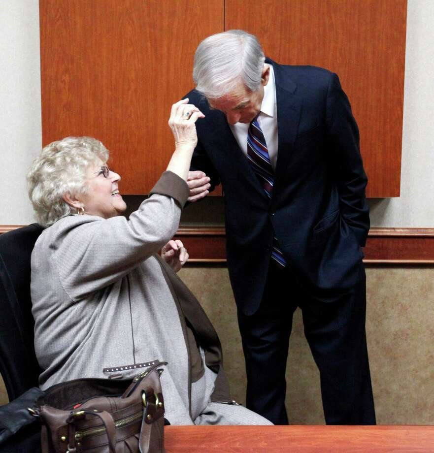 Carol Paul, wife of Ron Paul, fixes his hair before the North Dakota caucus, Tuesday, March 6, 2012 in Fargo, N.D. Photo: Charles Rex Arbogast, Associated Press / AP