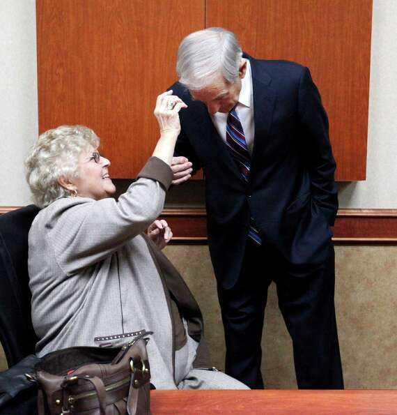 Carol Paul, wife of Ron Paul, fixes his hair before the North Dakota caucus, Tuesday, March 6, 2012