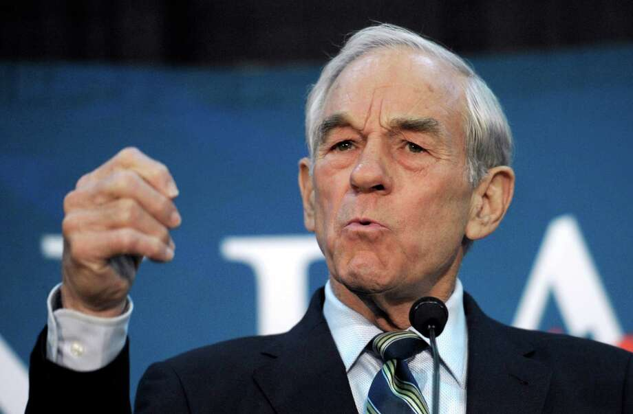 Republican presidential candidate Rep. Ron Paul, R-Texas, appears at a town hall meeting in College Park, Md., Wednesday, March 28, 2012. (AP Photo/Cliff Owen) Photo: Cliff Owen, Associated Press / FR170079 AP