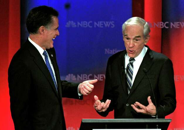 Republican presidential candidate, Rep. Ron Paul, R-Texas, right, laughs with former Massachusetts Gov. Mitt Romney during a break in a Republican presidential debate Monday, Jan. 23, 2012, at the University of South Florida in Tampa, Fla. (AP Photo/Chris O'Meara) Photo: Chris O'Meara, Associated Press / AP