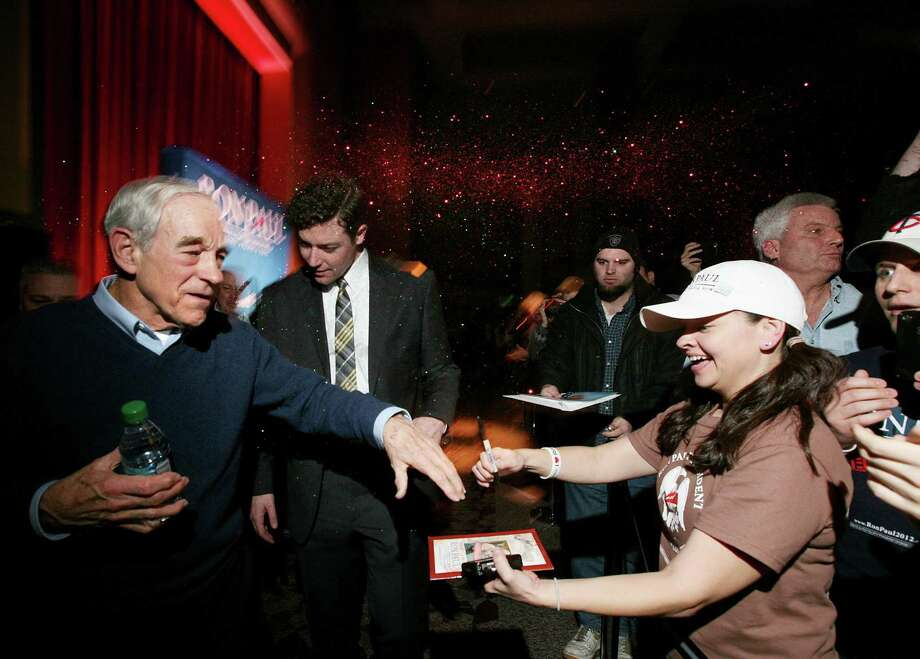 Ron Paul is glitter-bombed as he greets the crowd after speaking at a rally at the Minneapolis Convention Center Feb 6, 2012. Photo: Courtney Perry, Associated Press / Courtney Perry