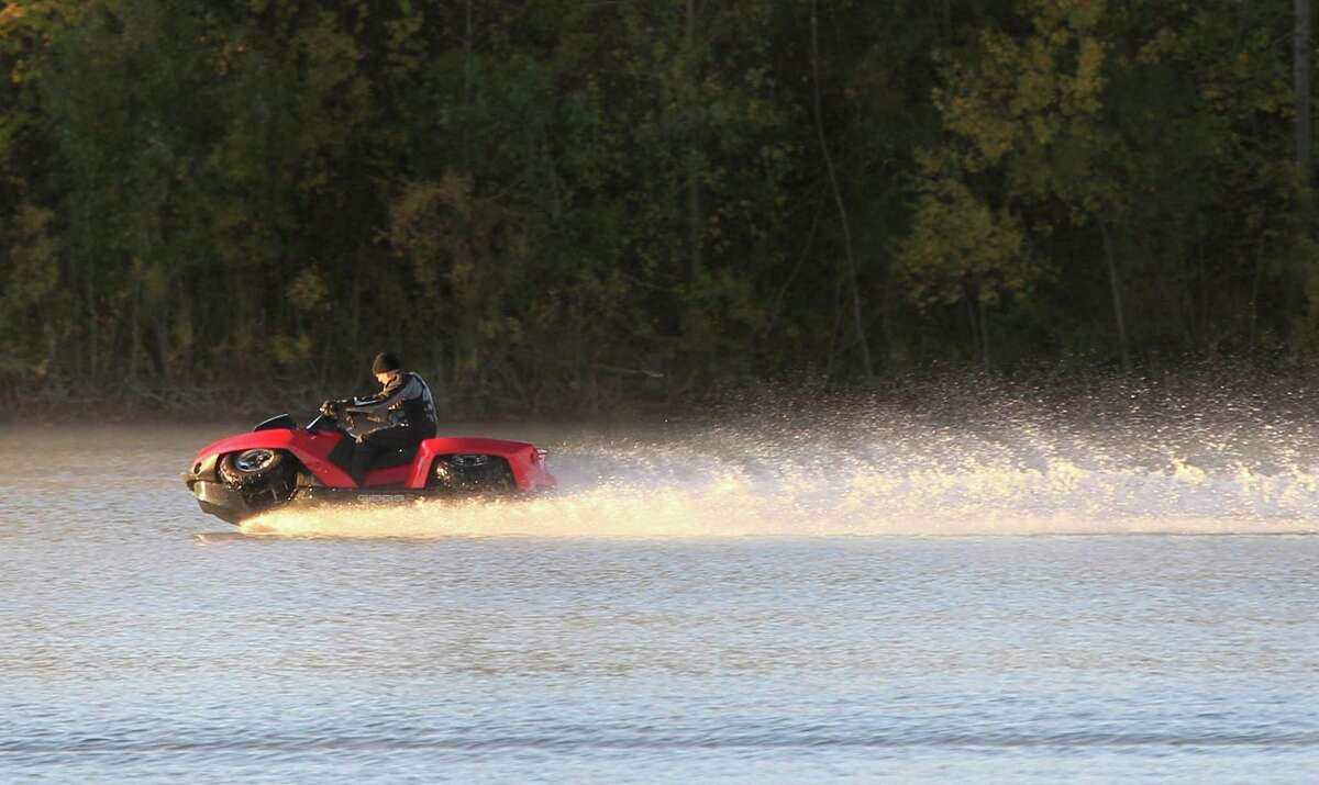 In this Friday, Oct. 12, 2012 photo, the Quadski, a one-person motor boat that also drives on land, is tested in in Oxford Mich. The vehicle is being billed as the first commercially available, high-speed amphibious vehicle by its makers, Michigan-based Gibbs Technologies. It's scheduled to go on sale in the U.S. by the end of this year for around $40,000. The company hopes to sell it worldwide by 2014.