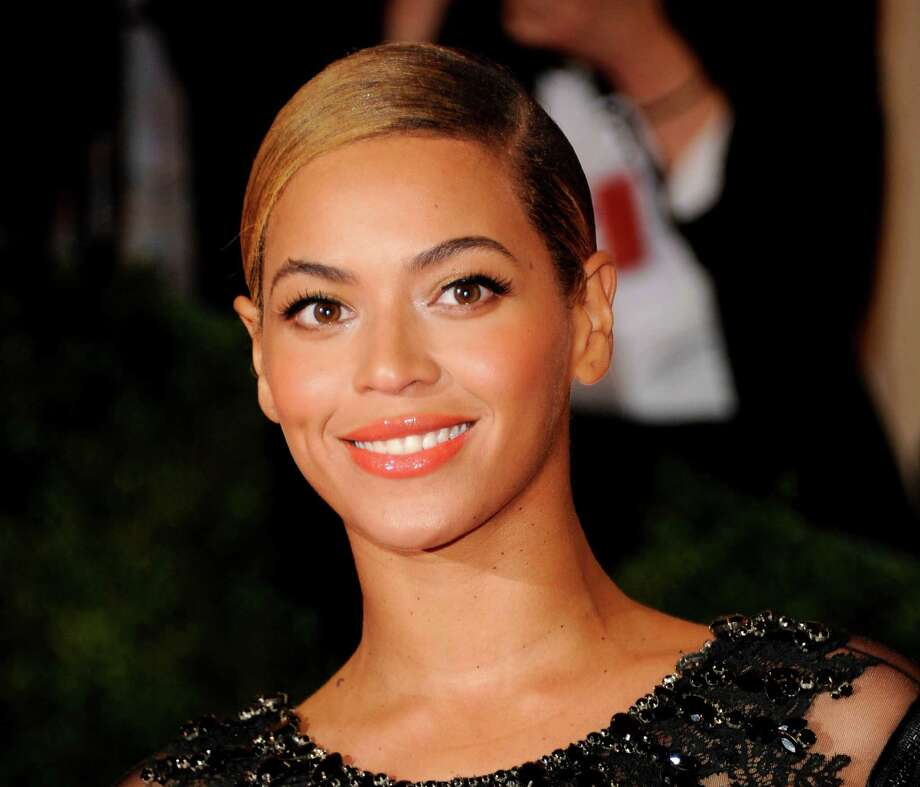 FILE - This May 7, 2012 file photo shows Beyonce Knowles at the Metropolitan Museum of Art Costume Institute gala benefit, celebrating Elsa Schiaparelli and Miuccia Prada in New York. A source familiar with Super Bowl XLVII told The Associated Press that the Grammy-winning diva will take the stage at the Pepsi NFL Halftime Show on Feb. 3, 2013 at the Mercedes-Benz Superdome in New Orleans, La.  (AP Photo/Evan Agostini, file) Photo: Evan Agostini, FRE / AGOEV