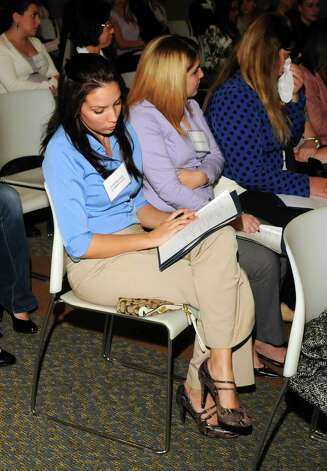 Stephanie Cardinale takes notes during a business etiquette dinner that was held at Western Connecticut State University on Tuesday October 9, 2012. Photo: Lisa Weir