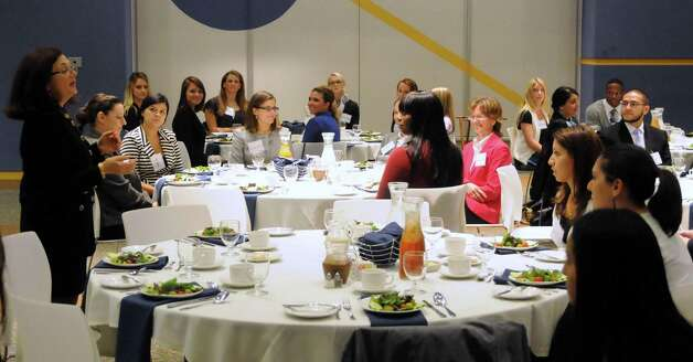 Anne Marie Sabath teaches at a business etiquette dinner that was held at Western Connecticut State University on Tuesday October 9, 2012. Photo: Lisa Weir / The News-Times Freelance