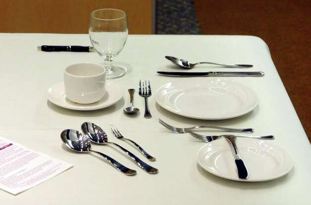A table setting helps Anne Marie Sabath teach at a business etiquette dinner that was held at Western Connecticut State University on Tuesday October 9, 2012. Photo: Lisa Weir / The News-Times Freelance