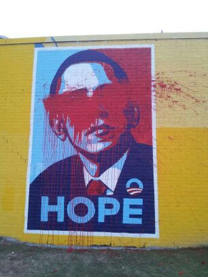 Vandals threw red paint on the mural of President Barack Obama facing The Breakfast Klub restaurant sometime early Monday (Courtesy photo, The Breakfast Klub) Photo: Handout