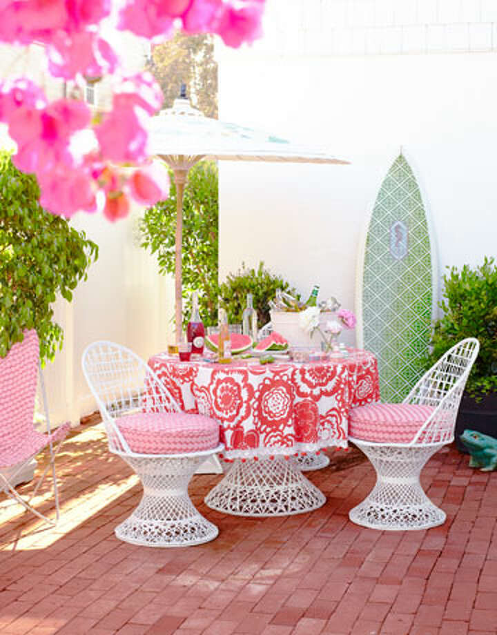 "Beach House Patio ""I was driving by a store in L.A., saw this 1960s patio furniture, and screeched to a stop,"" designer Kristen Ewart says. ""It's modern without being stark, and petite — there's not a lot of room out here."" See more photos of this California Beach House.  Reprinted with Permission of Hearst Communications, Inc. Originally Published: 15 Amazing Outdoor Rooms Photo: Victoria Pearson"