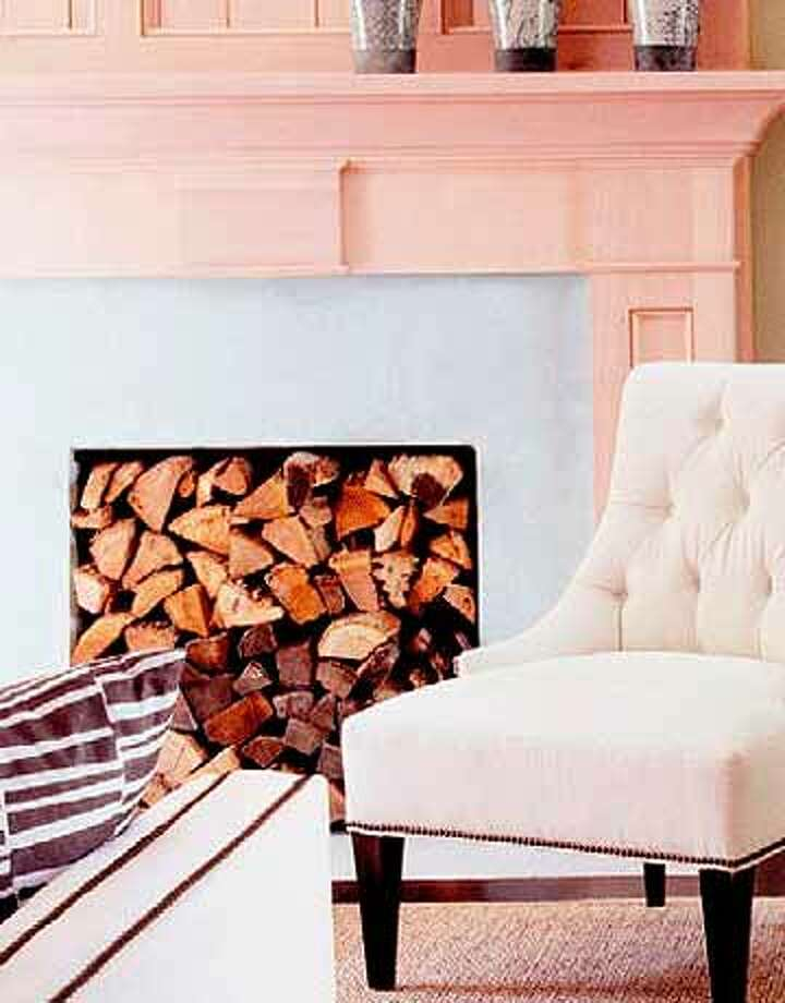 Store Your Firewood Artfully Out of season, stack your leftover wood — artfully — in your fireplace.  Reprinted with Permission of Hearst Communications, Inc. Originally Published: Simple Summer Makeovers