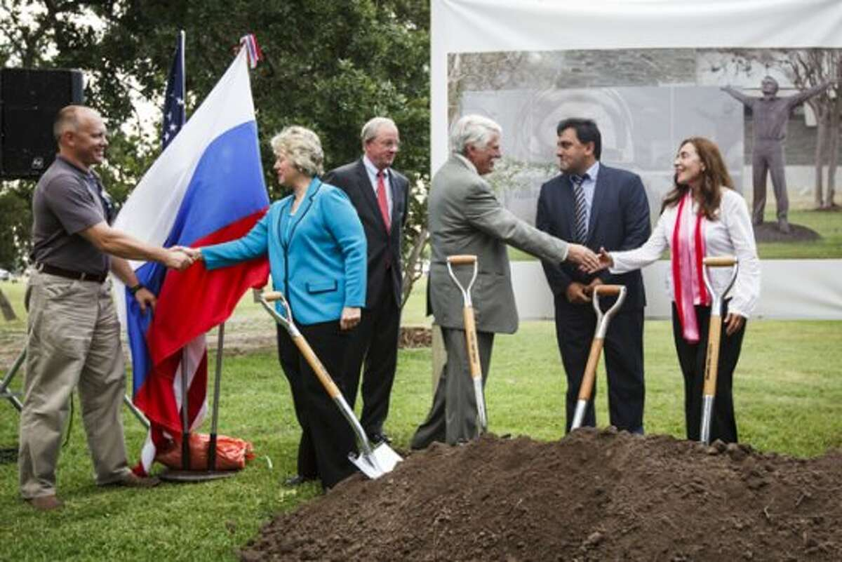 Mayor Annise Parker, second from left, shakes hands with Cosmonaut Oleg Artemiev, left, during the groundbreaking ceremony for artworks honoring the First Space Explorers to Orbit Earth, Russian Cosmonaut Yuri A. Gagarin and United States Astronaut John H. Glenn Jr., at the first headquarters of NASA in Houston, currently home to the Houston Parks & Recreation Department, Thursday, June 21, 2012, in Houston. (Michael Paulsen / Houston Chronicle)