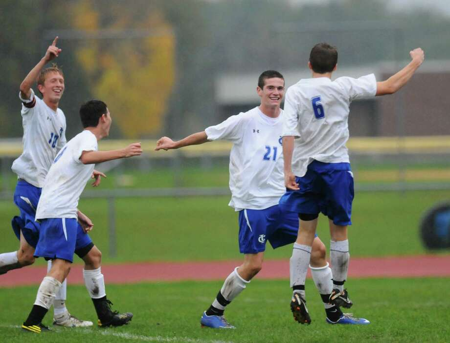 Ichabod Crane's Tyler Jablanski, left, Seth Scarano, second from left, Anthony DeChance, second from right, and Alex Niemann, right, celebrate after a goal during a game with Albany Academy on Monday Oct. 15, 2012 in Valatie, NY. (Philip Kamrass /  Times Union) Photo: Philip Kamrass / 00019624A