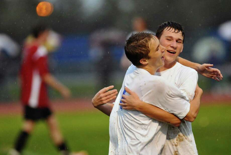 Ichabod Crane's Seth Scarano, right, celebrates with teammate Alex Niemann, left, after Scarano scored during a game against  Albany Academy on Monday Oct. 15, 2012 in Valatie, NY. (Philip Kamrass /  Times Union) Photo: Philip Kamrass / 00019624A