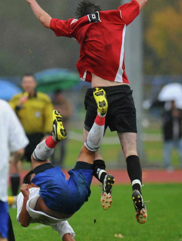 Ichabod Crane's Eduardo Gomez, left, collides with Albany Academy's Liam Maloy, right, on Monday Oct. 15, 2012 in Valatie, NY. (Philip Kamrass /  Times Union) Photo: Philip Kamrass / 00019624A