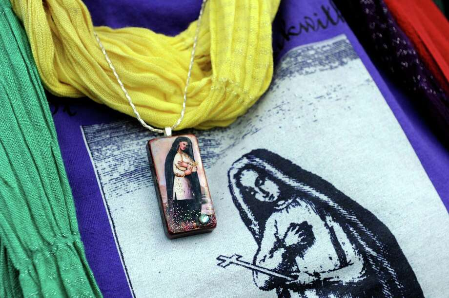 Jennifer Richard-Morrow of Albany wears a necklace and T-shirt adorned with the likeness of Blessed Kateri Tekakwitha, the first Native American saint, on Tuesday, Oct. 16, 2012, at St. Pius X Church in Loudonville, N.Y. Richard-Morrow was part of the pilgrimage to Rome for the saint's canonization. (Cindy Schultz / Times Union) Photo: Cindy Schultz / 00019676A