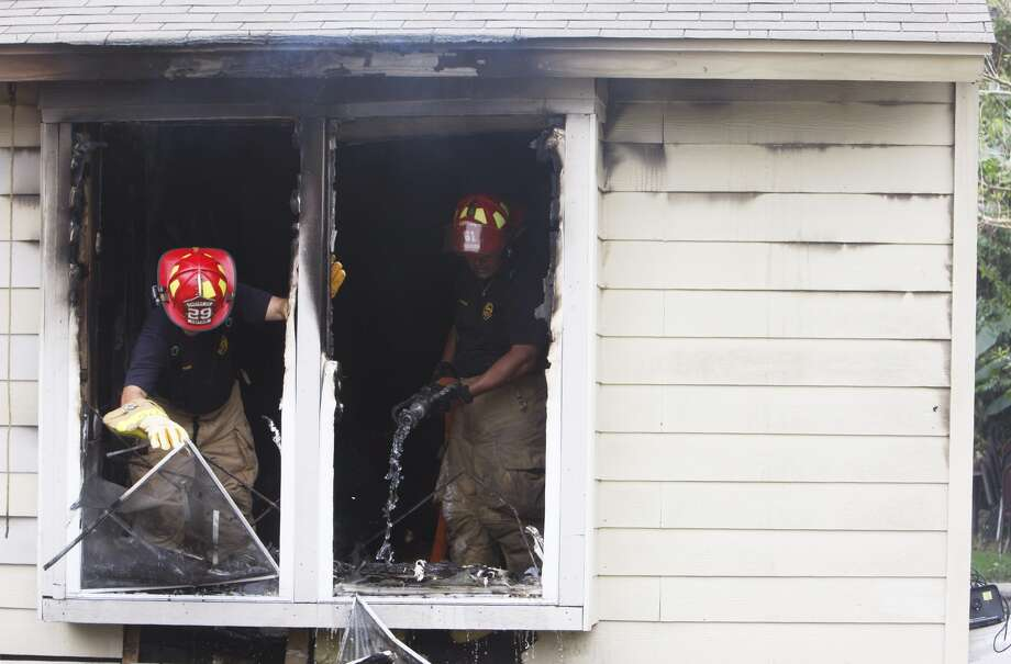 Houston firefighters work on a 1-alarm blaze in the 12100 block of Dumas in southeast Houston Tuesday, Oct. 16, 2012. Photo: .