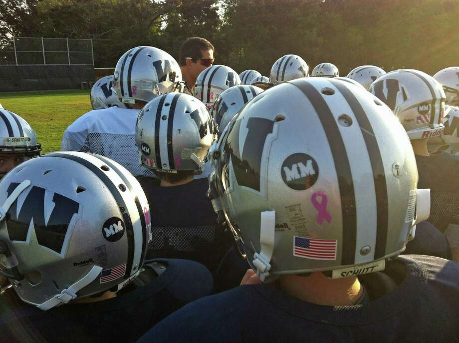 "Westport PAL football has dedicated its season to the late coach Matt McCoy and players have worn helmet stickers showing McCoy's initials, ""M M"" this year. Photo: Contributed Photo"