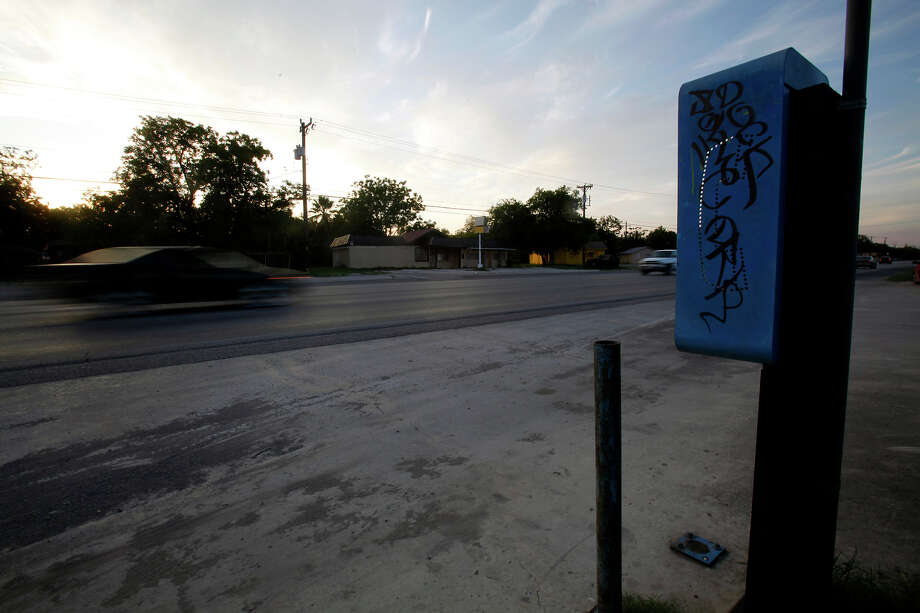 An old pay phone with graffiti sits along Roosevelt Avenue neat the Mission Drive -In redevelopment. City officials say they want to clean up the arte. File photo Photo: Shaminder Dulai, San Antonio Express-News / sdulai@express-news.net