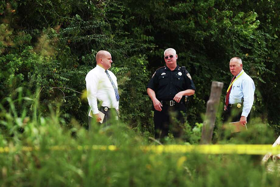 Authorities investigate skeletal  remains found in a plastic trash bag off Old Walters Road in north Harris County Tuesday, Oct. 16, 2012. (Johnny Hanson / Houston Chronicle) Photo: .