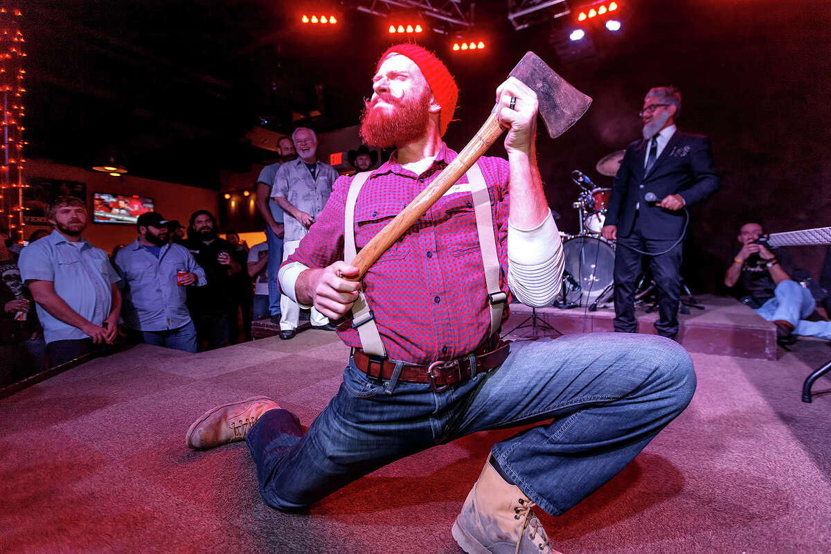 Wes Dunn, competing in the best groomed category, plays up to the crowd during the Battle of Beards.