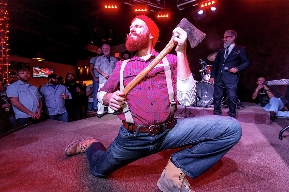 Wes Dunn, competing in the best groomed category, plays up to the crowd during the Battle of Beards. Photo: MARVIN PFEIFFER, STAFF / Express-News 2012
