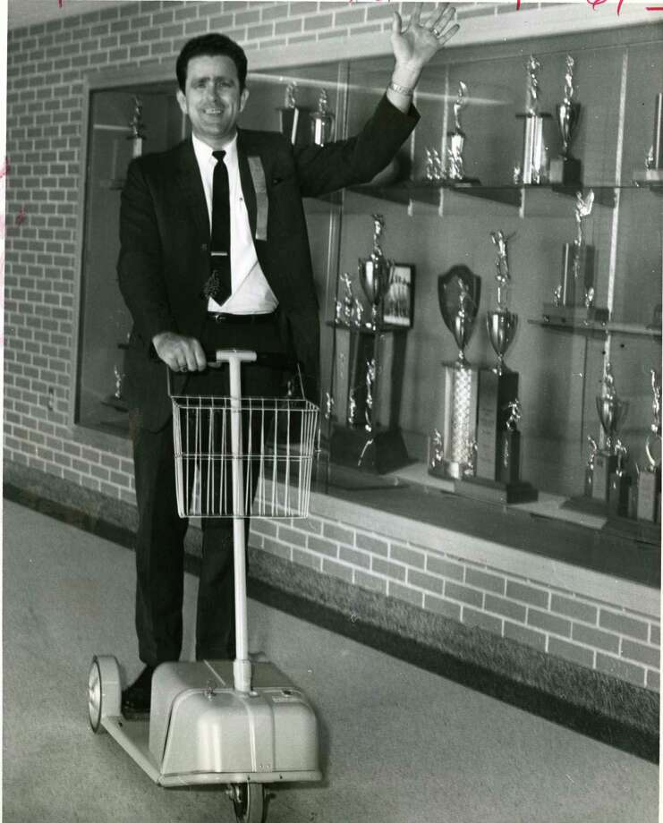 James L. Lewis, a Lee High assistant principal in 1968, traveled around campus on a battery-operated scooter. Photo: Larry Evans