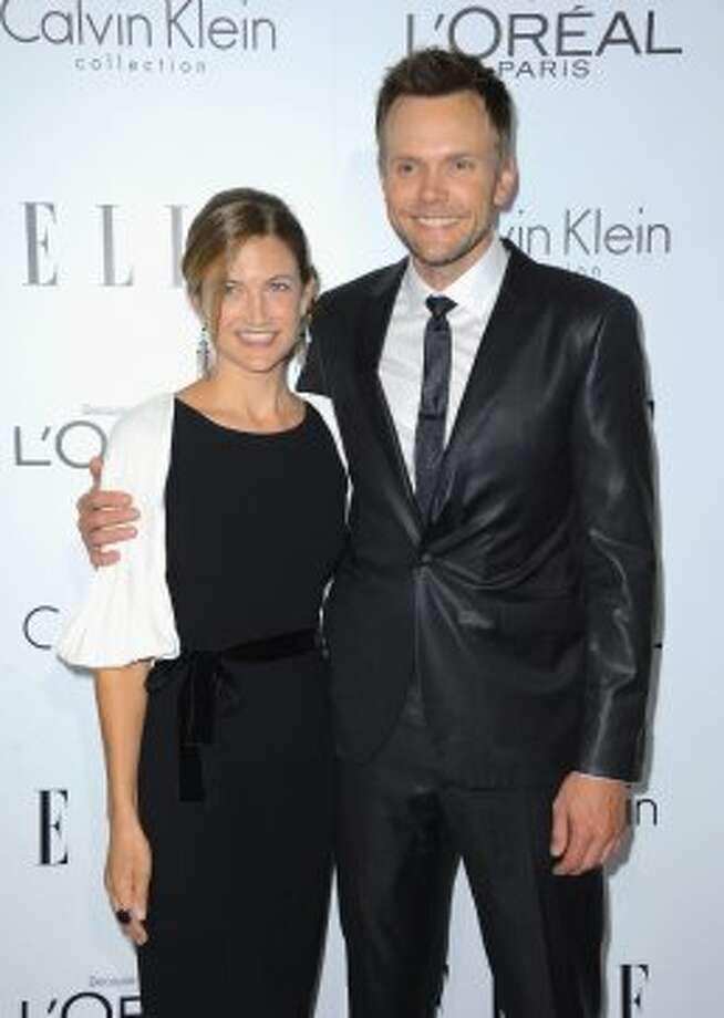 Actor Joel McHale (R) and Sarah Williams arrive at ELLE's 19th Annual Women In Hollywood Celebration at the Four Seasons Hotel on October 15, 2012 in Beverly Hills, California. (Frazer Harrison / Getty Images)