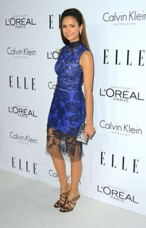 Actress Nina Dobrev arrives at ELLE's 19th Annual Women In Hollywood Celebration at the Four Seasons Hotel on October 15, 2012 in Beverly Hills, California.  (Frazer Harrison / Getty Images)