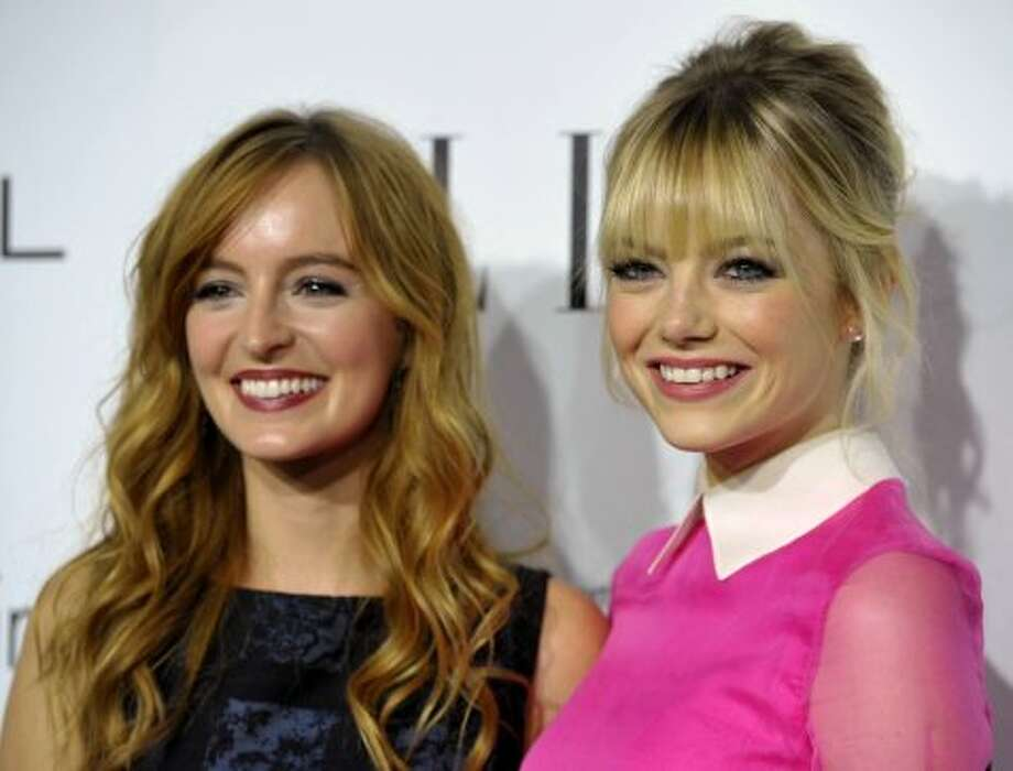 Actresses Ahna O'Reilly, left, and Emma Stone attend the 19th Annual ELLE Women In Hollywood Celebration in Los Angeles on Monday, Oct. 15, 2012.  ( John Shearer/Invision / Associated Press)
