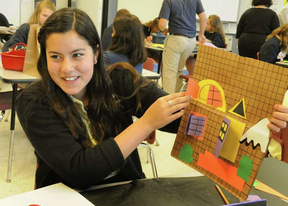 St. Anthony of Padua Catholic School seventh-grader Paula Galan opens a door on her three dimensional project during an art class.  The school was recently honored with the U.S. Department of Education's Blue Ribbon Schools Program. Photo: David Hopper / freelance