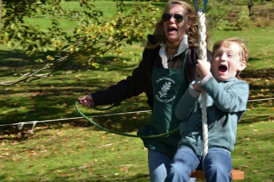 It is debatable who is having more fun at the New Canaan Nature Center Fall Fair - volunteer Eileen Boyd or 7-year-old Christian Passios!  Oct. 13, 2012, New Canaan, Conn. Photo: Jeanna Petersen Shepard