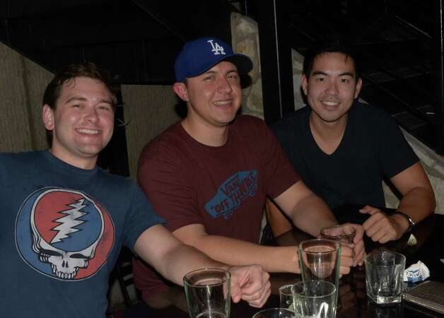 Michael Lewis (from left), Juan Higuera (cq) and James Chin (cq) drink on the outdoor patio that overlooks the Riverwalk at The Worm on October 13, 2012. Robin Johnson Photo: Robin Johnson