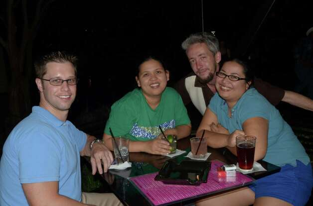 Lee Harmon (from left), Rowena Reyes (cq), Clint Justl (cq) and Regina Reyes drink by the Riverwalk on the outdoor patio of The Worm on October 13, 2012. Robin Johnson Photo: Robin Johnson