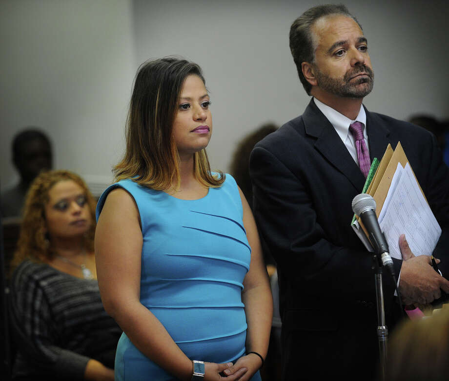 Bridgeport state representative candidate Christina Ayala and her attorney Guy Soares enter a not guilty plea in Superior Court in Bridgeport on Tuesday, October 16, 2012. Photo: Brian A. Pounds / Connecticut Post