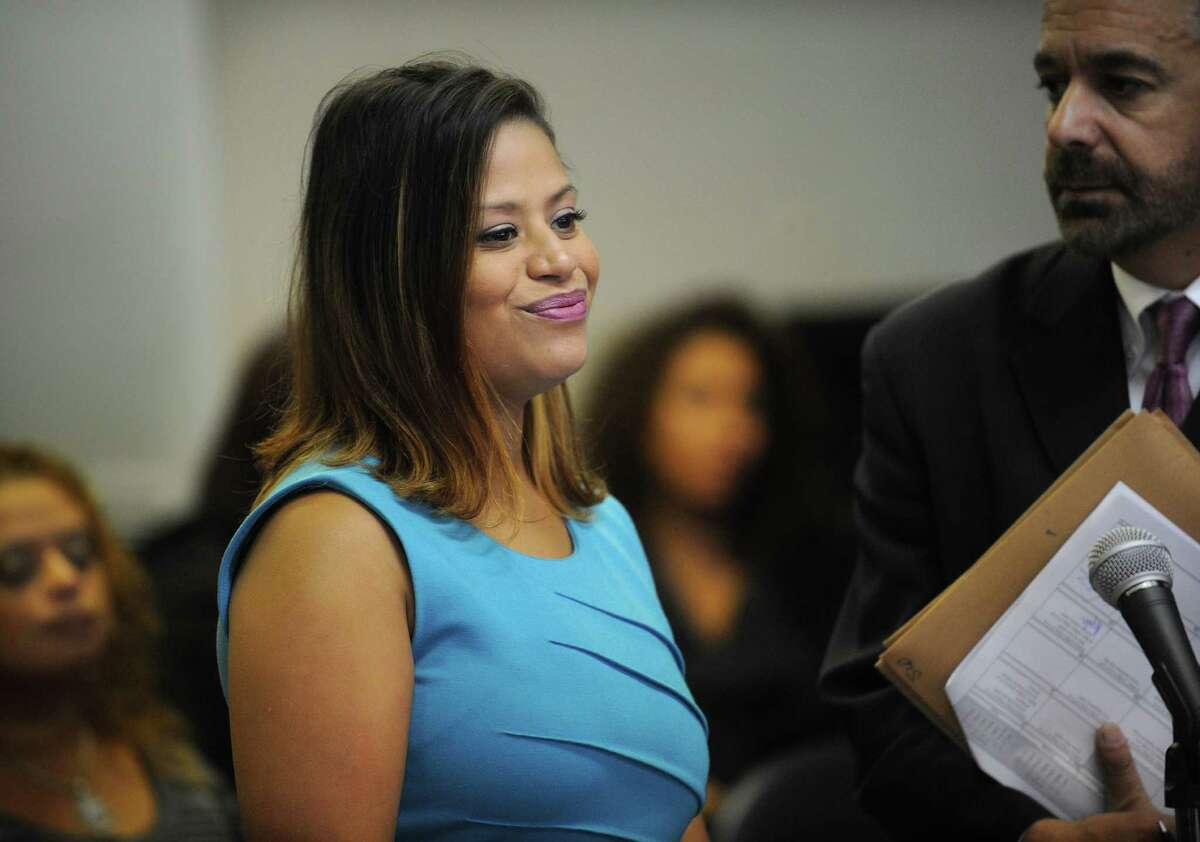 Bridgeport state representative candidate Christina Ayala smiles towards the judge as she and her attorney Guy Soares enter a not guilty plea in Superior Court in Bridgeport on Tuesday, Octber 16, 2012.