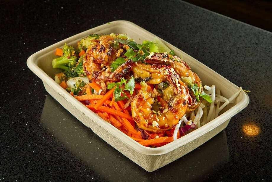At Asian Box in Palo Alto, diners can create their own dishes, such as basil lime shrimp over salad, above, by starting with a base (rice, noodles or salad), then a protein like chicken, right, then a choice of steamed or wok-tossed vegetables. Executive chef Grace Nguyen, far right, has cooked at Slanted Door and Bush Street OTD. Photo: John Storey, Special To The Chronicle