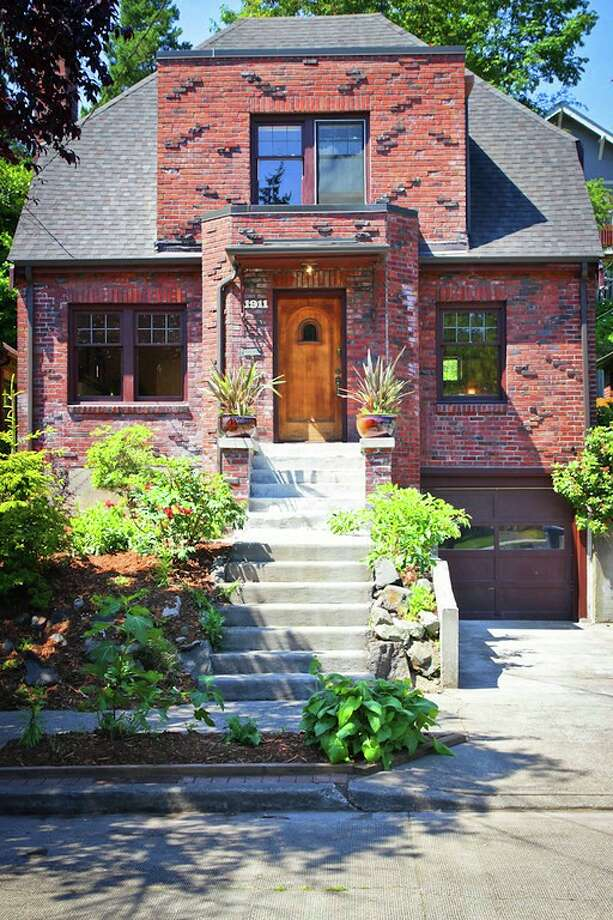 Montlake is a gorgeous Seattle neighborhood tucked between Capitol Hill, Washington Park Arboretum, Portage Bay, Union Bay and the University of Washington. Here are three 1920s homes listed there for less than $700,000, starting with 1911 26th Ave. E. The 2,800-square-foot brick house, built in 1929, has three bedrooms, 1.5 bathrooms, Mahogany millwork and doors, a media/game room, a basement office, a patio and a garden on a 3,880-square-foot lot. It's listed for $675,000. Photo: Val Mohney, Courtesy Donovan Shelton And Scott Burdette/Windermere Real Estate