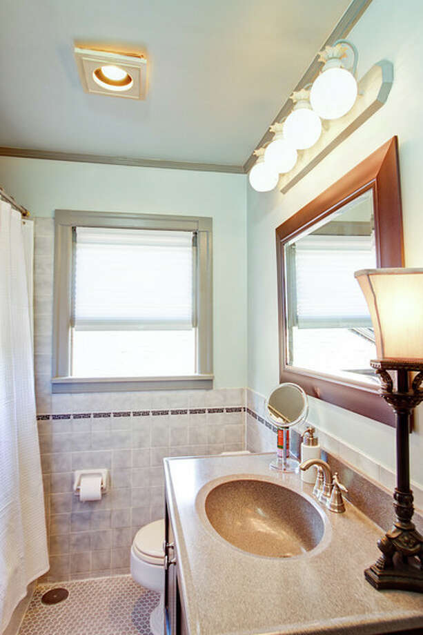 Bathroom of 1911 26th Ave. E. The 2,800-square-foot brick house, built in 1929, has three bedrooms, 1.5 bathrooms, Mahogany millwork and doors, a media/game room, a basement office, a patio and a garden on a 3,880-square-foot lot. It's listed for $675,000. Photo: Val Mohney, Courtesy Donovan Shelton And Scott Burdette/Windermere Real Estate