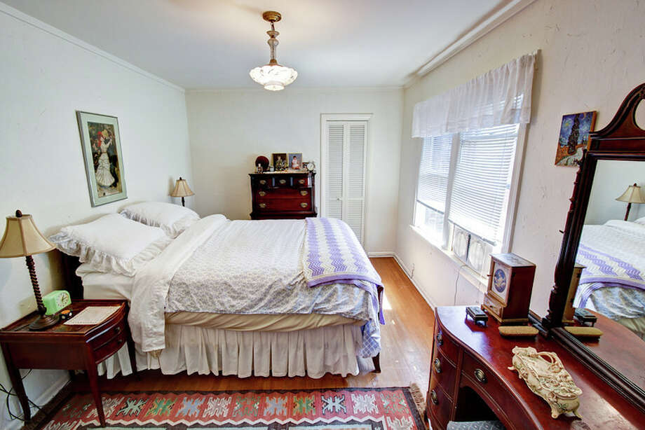 Bedroom of 1911 26th Ave. E. The 2,800-square-foot brick house, built in 1929, has three bedrooms, 1.5 bathrooms, Mahogany millwork and doors, a media/game room, a basement office, a patio and a garden on a 3,880-square-foot lot. It's listed for $675,000. Photo: Val Mohney, Courtesy Donovan Shelton And Scott Burdette/Windermere Real Estate