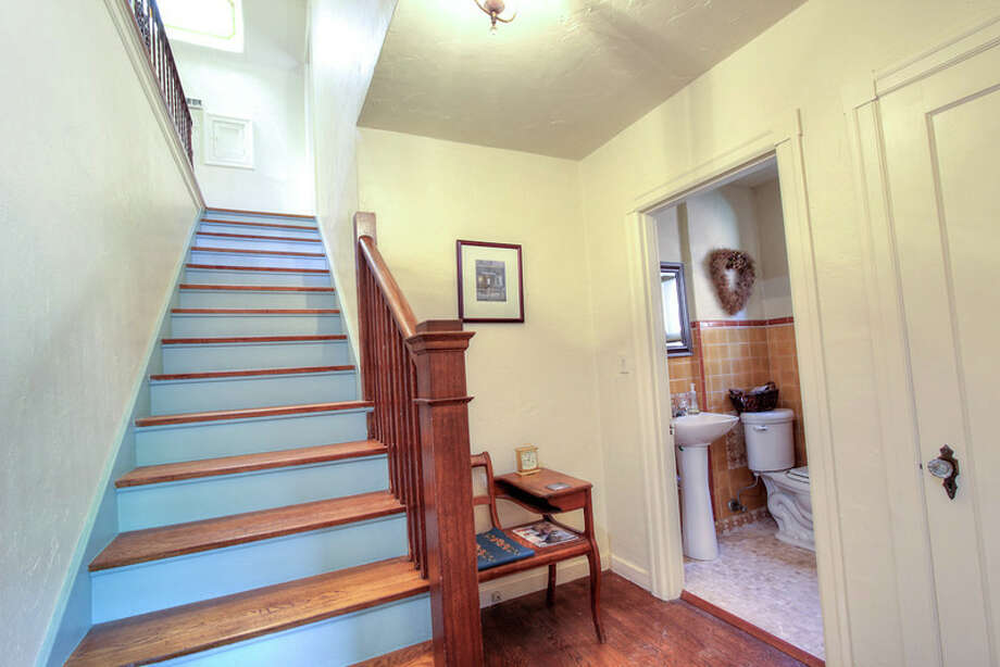 Stairway of 1911 26th Ave. E. The 2,800-square-foot brick house, built in 1929, has three bedrooms, 1.5 bathrooms, Mahogany millwork and doors, a media/game room, a basement office, a patio and a garden on a 3,880-square-foot lot. It's listed for $675,000. Photo: Val Mohney, Courtesy Donovan Shelton And Scott Burdette/Windermere Real Estate