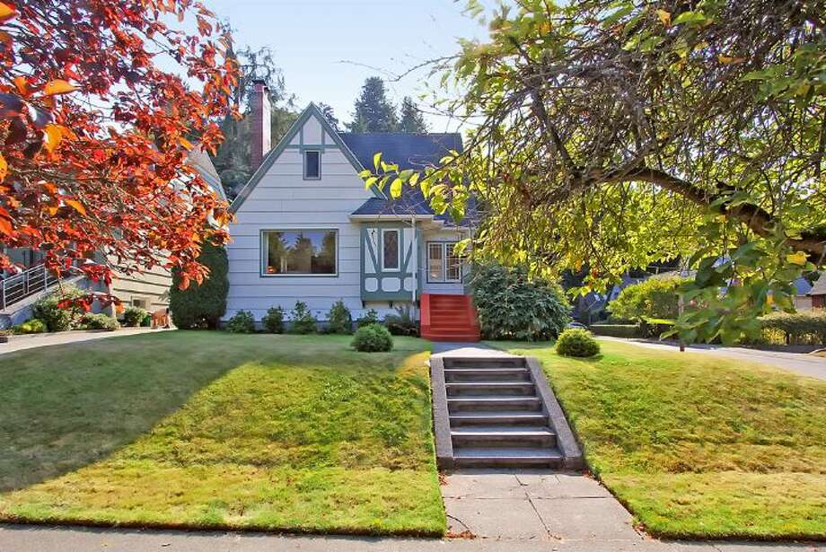 Front of 1961 Boyer Ave. E. The 1,960-square-foot Tudor, built in 1926, has three bedrooms, 1.5 bathrooms, half-timbering, leaded windows, arched doorways, coved ceilings, built-in shelves and a patio on a 4,000-square-foot corner lot. It's listed for $685,000. Photo: Courtesy Darcy LaBelle/Windermere Real Estate