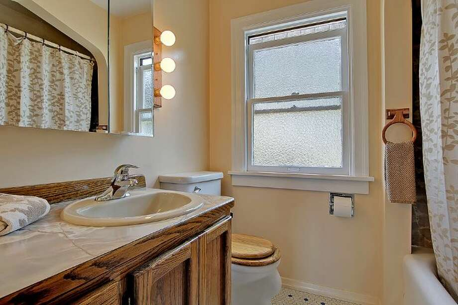 Bathroom of 1961 Boyer Ave. E. The 1,960-square-foot Tudor, built in 1926, has three bedrooms, 1.5 bathrooms, half-timbering, leaded windows, arched doorways, coved ceilings, built-in shelves and a patio on a 4,000-square-foot corner lot. It's listed for $685,000. Photo: Courtesy Darcy LaBelle/Windermere Real Estate