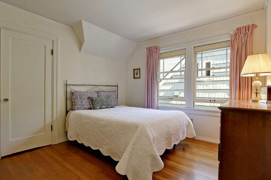 Bedroom of 1961 Boyer Ave. E. The 1,960-square-foot Tudor, built in 1926, has three bedrooms, 1.5 bathrooms, half-timbering, leaded windows, arched doorways, coved ceilings, built-in shelves and a patio on a 4,000-square-foot corner lot. It's listed for $685,000. Photo: Courtesy Darcy LaBelle/Windermere Real Estate