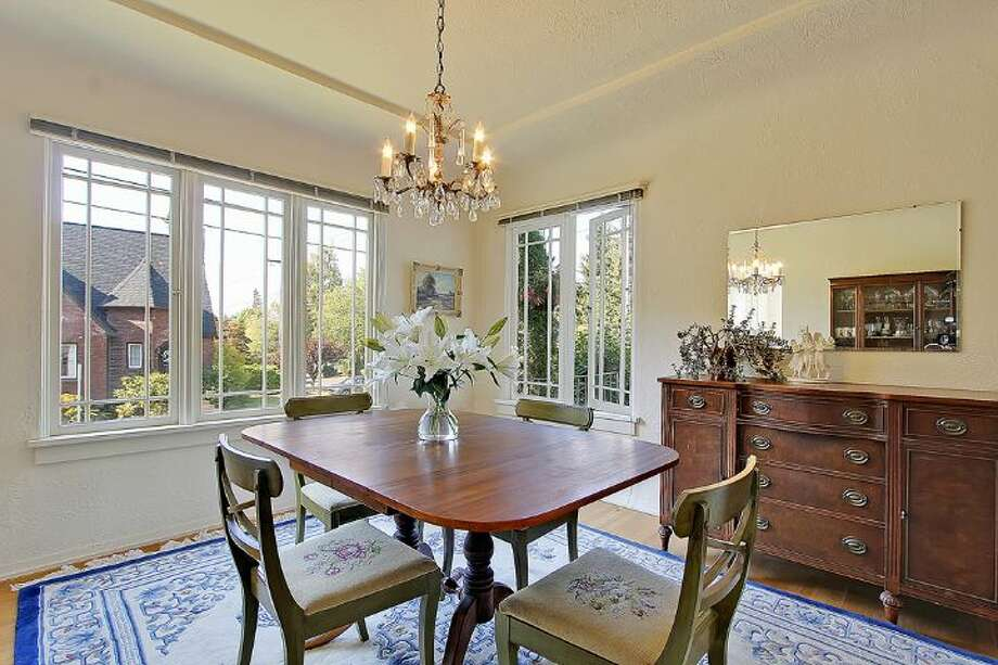 Dining room of 1961 Boyer Ave. E. The 1,960-square-foot Tudor, built in 1926, has three bedrooms, 1.5 bathrooms, half-timbering, leaded windows, arched doorways, coved ceilings, built-in shelves and a patio on a 4,000-square-foot corner lot. It's listed for $685,000. Photo: Courtesy Darcy LaBelle/Windermere Real Estate