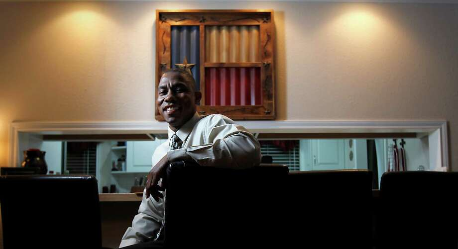 Rodney Pearson, a law enforcement officer with more than 20 years experience, is in the center of controversy, as he is photographed at home, Tuesday, Aug. 30, 2011, in Jasper, Texas.  Pearson was named Chief of police in Jasper, by the city council, but was disputed by citizens in the community, which has sparked debate in the city, dividing the city along racial lines. Several citizens in Jasper have signed a petition asking to recall council members Terrya Norsworthy and her fellow  councilmen Willie Land and Tommy Adams. ( Karen Warren / Houston Chronicle ) Photo: Karen Warren, Staff / © 2011 Houston Chronicle