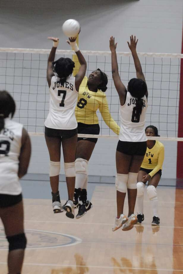 Dominique Brown (#8) (center) shoots for Washington as Eboni Johnson (#7) and Margaret Johnson (#6) defend for Jones during their game at Delmar fieldhouse Friday 9/16/11. Photo by Tony Bullard. Photo: Tony Bullard / Credit: for the Chronicle