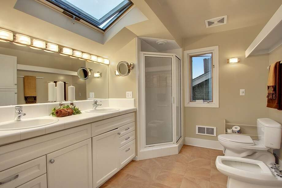Bathroom of 1935 E. Calhoun St. The 2,630-square-foot Craftsman, built in 1920, has three bedrooms, 1.75 bathrooms, leaded windows, built-ins, a kitchen skylight, air conditioning, a front porch and a back patio on a 3,800-square-foot lot. It's listed for $699,950. Photo: Courtesy Dianne Girard/Windermere Real Estate